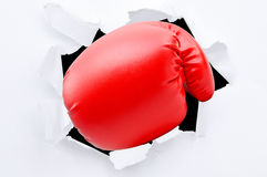Punching boxing glove. Though over white paper Royalty Free Stock Image