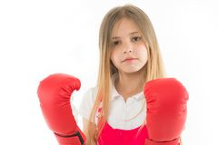 Punching. Childhood development and health. Success. Adorable boxer isolated on white. Fitness trainer. Girl in red royalty free stock photos