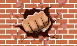 Punching fist smash through a concrete and brick wall Royalty Free Stock Photos