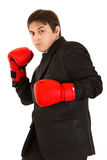 Punching furious businessman with boxing gloves Stock Photography