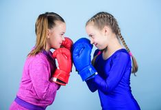 Punching knockout. Childhood activity. Fitness diet. energy health. workout of small girls boxer in sportswear. Sport royalty free stock image