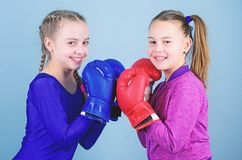 Punching knockout. Childhood activity. Fitness. energy health. Sport success. Friendship. Happy children sportsman in. Boxing gloves. workout of small girls royalty free stock images
