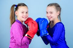 Punching knockout. Childhood activity. Fitness. energy health. Sport success. Friendship. Happy children sportsman in. Boxing gloves. workout of small girls stock photos
