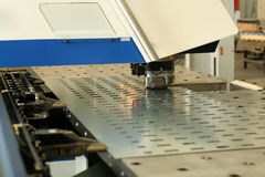 Punching machine. High precision CNC sheet metal stamping and punching machinery Royalty Free Stock Photos