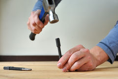 Punching nails Stock Photo