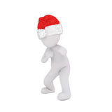 Punching or reaching out figure in santa hat Stock Images