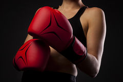 Punching with red boxing gloves, fight concept Royalty Free Stock Images