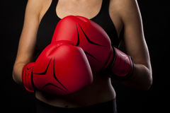 Punching with red boxing gloves, fight concept Stock Photo