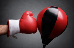 Punching a red punch bag Stock Photo