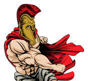 Punching spartan mascot Stock Image