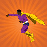Punching superhero Royalty Free Stock Photos