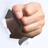 Punching though over white paper Royalty Free Stock Image