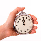 Punctuality. Clock in young female hands stock images