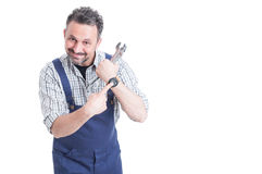 Punctuality concept with cheerful mechanic showing his wrist wat. Ch with copyspace isolated on white royalty free stock photography