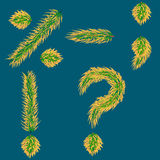 punctuation marks on the background of green needles alphabet Stock Photo