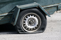 Punctured tyre. A punctured tyre on a trailer Royalty Free Stock Photos