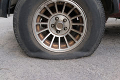 Punctured tyre. A abandoned car Royalty Free Stock Image