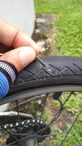Punctured tyre. A puncture in rear wheel of bicycle due to small sharp object royalty free stock photos