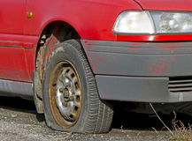 Punctured wheel. On old car from 80s royalty free stock images