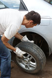 Punctured wheel. The man changes the punctured wheel of the car stock photography