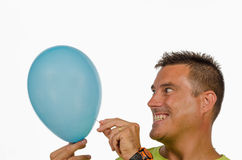 Puncturing a balloon Royalty Free Stock Photography