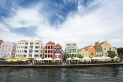 Punda Curacao, Handelskade. Colourfull, touristic and historical quay at the harbour of Punda, Curacao. With terraces and buildings Royalty Free Stock Photography