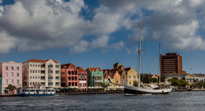 Punda waterfront and a sail boat Royalty Free Stock Images