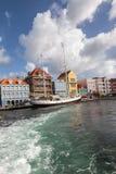 Punda waterfront and a sail boat Royalty Free Stock Photos
