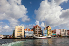 Punda waterfront and a sail boat. Punda Waterfront- Views around Curacao Caribbean island Stock Photo