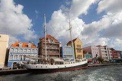 Punda waterfront and a sail boat Stock Photos