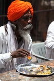Pune, India  - July 11, 2015: A hindu pilgrim having a mea. L served to him by a charitable organization, during the Wari festival in India Royalty Free Stock Image