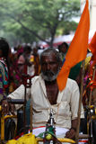 Pune, India  - July 11, 2015: An old Indian pilgrim. In a traditional attire during a religious wari pilgrimmage festival in India Stock Photos