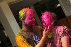 PUNE, INDIA, March 2018, Young India couple enjoy Holi and applying dry color to each other. stock images