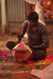 Pune, India - November 7, 2015: A man making a traditional sky l. Antern in his shop on the occasion of Diwali festival in India Royalty Free Stock Photography