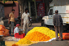 Pune, India - October 21, 2015: Festive Flower Shop. Pune, India - October 21, 2015: A man selling marigold flowers to a customer on the streetside in India, on Stock Photos