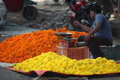 Pune, India - October 21, 2015: Flower Shop. Pune, India - October 21, 2015: A man setting up his marigold flower shop on the streetside in India, on the eve of Royalty Free Stock Photos