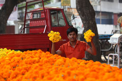 Pune, India - October 21, 2015: Flowers Display. Pune, India - October 21, 2015: A man shows off his fresh marigold flowers in his streetside shop in India, on Royalty Free Stock Photos