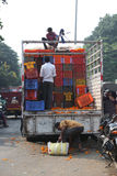 Pune, India - October 21, 2015: Unloading Marigold. Pune, India - October 21, 2015: Farmers unloading boxes of Marigold flowers for sale on the eve of Dassera Stock Image