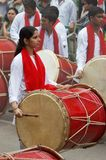 PUNE, INDIA, October 2016, Young girl and group play drum or dhol during Ganesh Festival. PUNE, INDIA, October 2016, Young girl and group play drum or dhol royalty free stock photo