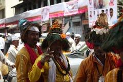 Pune, Indien - July 11, 2015: Eine Gruppe von traditionellem Vasudevs Stockbilder