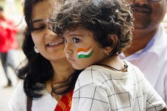 PUNE, MAHARASHTRA, INDIA, 15 Aug 2018, Small baby with Indian tri color painted on cheek with his mother celebrating Independence royalty free stock images