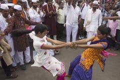 PUNE, MAHARASHTRA, INDIA, June 2016, Pilgrims performing fugadi, a rural dance form at Pandharpur Yatra. PUNE, MAHARASHTRA, INDIA, June 2016, Pilgrims performing royalty free stock photo