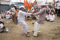 PUNE, MAHARASHTRA, INDIA, June 2016, Pilgrims performing fugadi, a rural dance form at Pandharpur Yatra. PUNE, MAHARASHTRA, INDIA, June 2016, Pilgrims performing stock photo