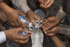PUNE, MAHARASHTRA, INDIA, June 2016, Pilgrims or warkari filli up the water bottles, Pandharpur Palkhi. PUNE, MAHARASHTRA, INDIA, June 2016, Pilgrims or warkari royalty free stock photo
