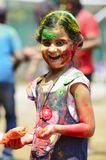 PUNE, MAHARASHTRA, INDIA, 24 March 2016. A young girl with colored powder on her face celebrating holi festival in Pune stock photo
