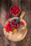 Pungent peppers bhut jolokiaon wooden table Royalty Free Stock Images