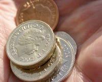 Punhado das moedas fotografia de stock