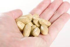 Punhado das vitaminas Foto de Stock Royalty Free