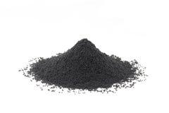 Punhado do pó granulado do carbono Imagem de Stock