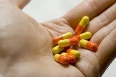 Punhado dos comprimidos Foto de Stock